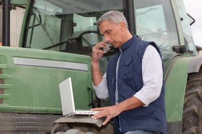 Farmer on phone (photo)